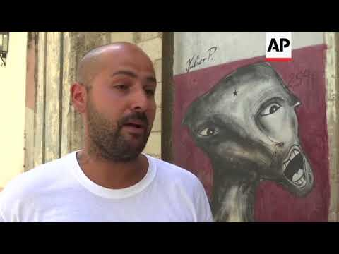 Cuban artist says he was detained, told to erase murals