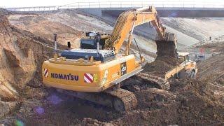 komatsu pc450lc 7 excavator loading cat 735b and volvo a30 dumpers