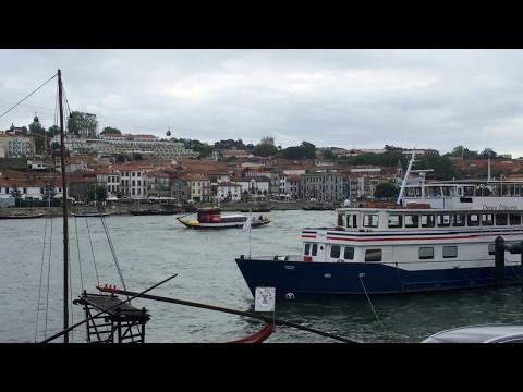 Small tourists cruise boat sailing across Douro River - Porto, Portugal