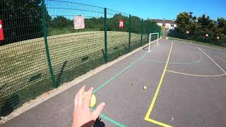 Two guys BADLY playing tennis for excersise