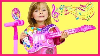 HELENA PLAYS WITH DISNEY PRINCESS TOY GUITAR MAGIC AND STARS A BAND thumbnail