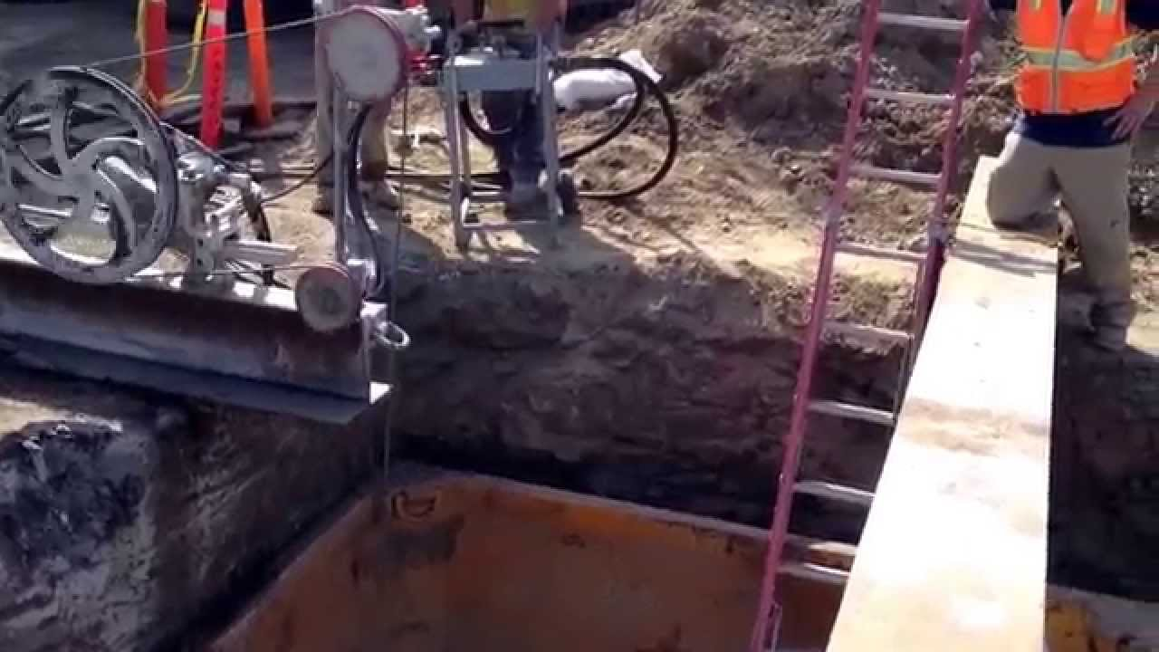 G&F Concrete Cutting performing a wire saw cut on a sewer pipe- Cal ...