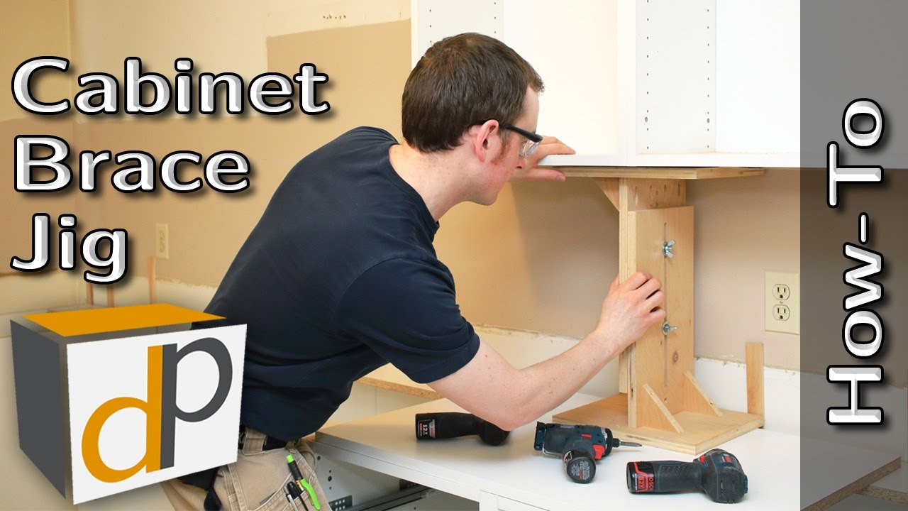 installing used kitchen cabinets hang cabinets by yourself cabinet brace how to 17933