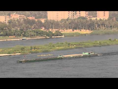 A barge on the nile river is slowing down so rowers are not harmed  5629