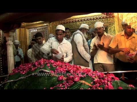 Devotees offering rose petals at the shrine of Nizamuddin Auliya