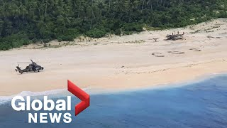 """""""SOS"""" message written in the sand saves 3 men stranded on remote Pacific island"""