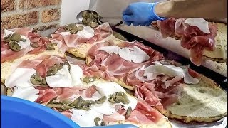 Italy Street Food. Huge Dose of Overloaded 'Spianata' Flat Bread with Ham, Cheese and More