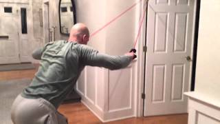 How to do pull-ups with a resistance band and a door
