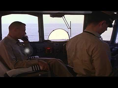 The Commanding Officer and the Deck Officer seated on the bridge of aircraft carr...HD Stock Footage