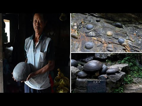 """Mysterious Cliff that Lays """"EGG"""" shaped Stones every 30 years in China"""