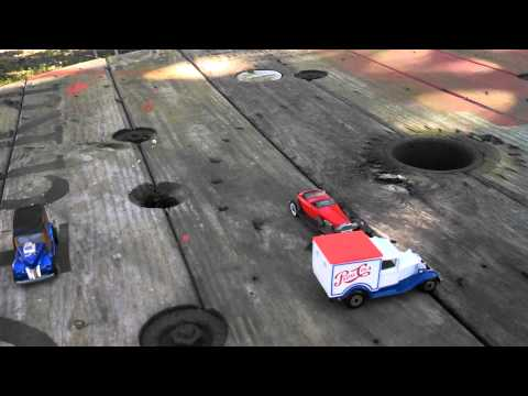 Motion: reference points and relative motion using toy cars
