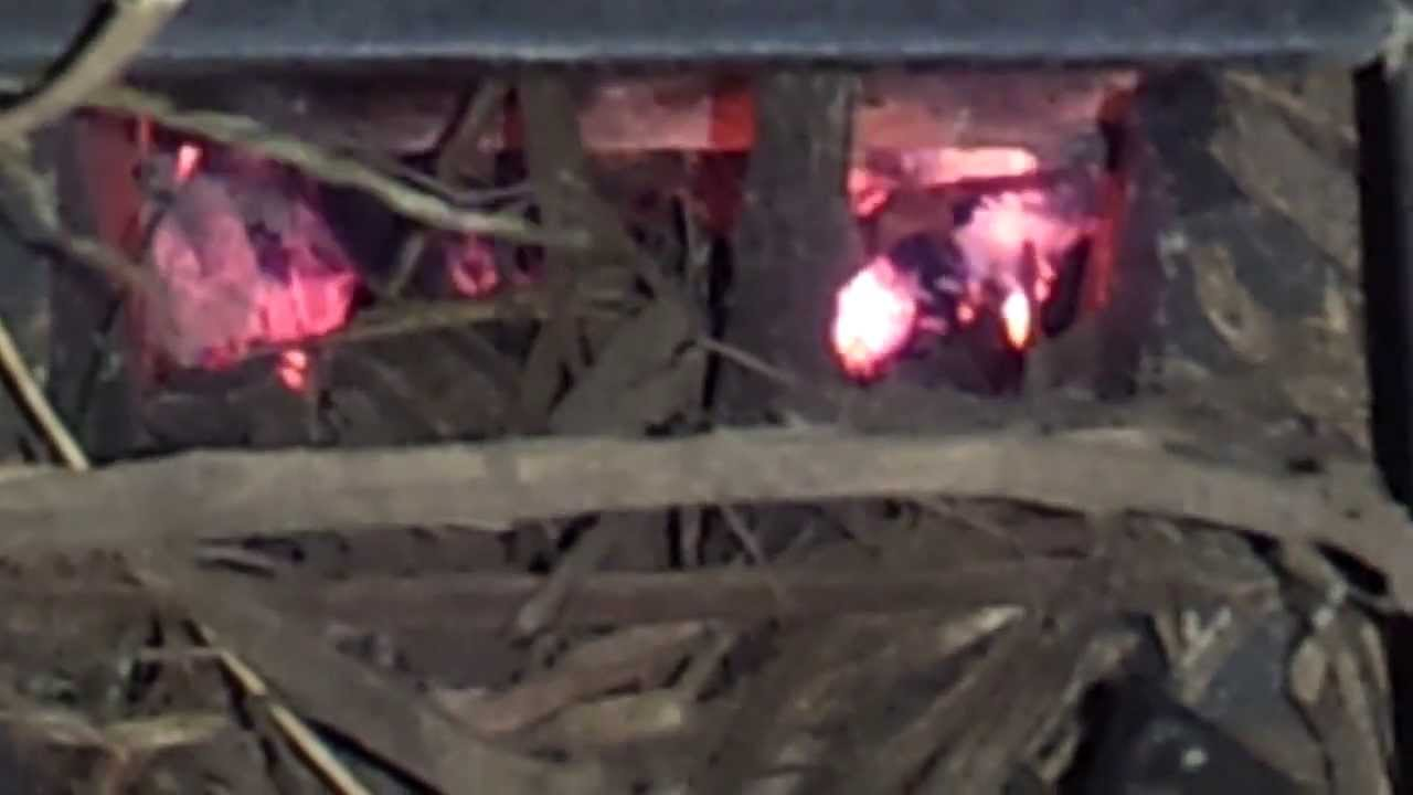 Burning wood chips in the rocket heater youtube