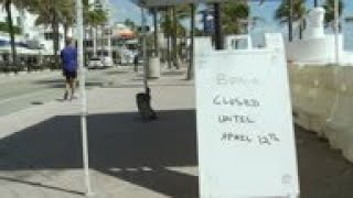 Tourists visit beaches despite virus warning