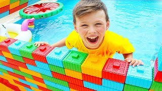 Adriana wants swim Ali made Color Brick Block Wall Toy in Pool