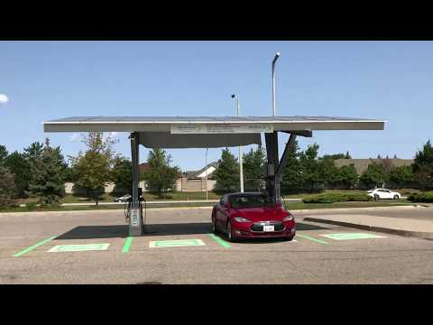 Charging my Tesla at a solar powered charging station