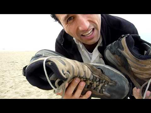 Francis Tapon shows you his extremely worn out shoes after El Camino de Santiago