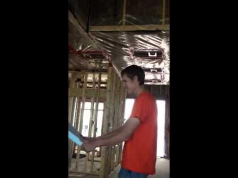 Electrician breaks styrofoam boards over head