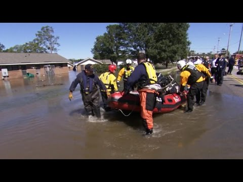 Rescuers evacuating multiple residents from rising floodwaters near New Bern