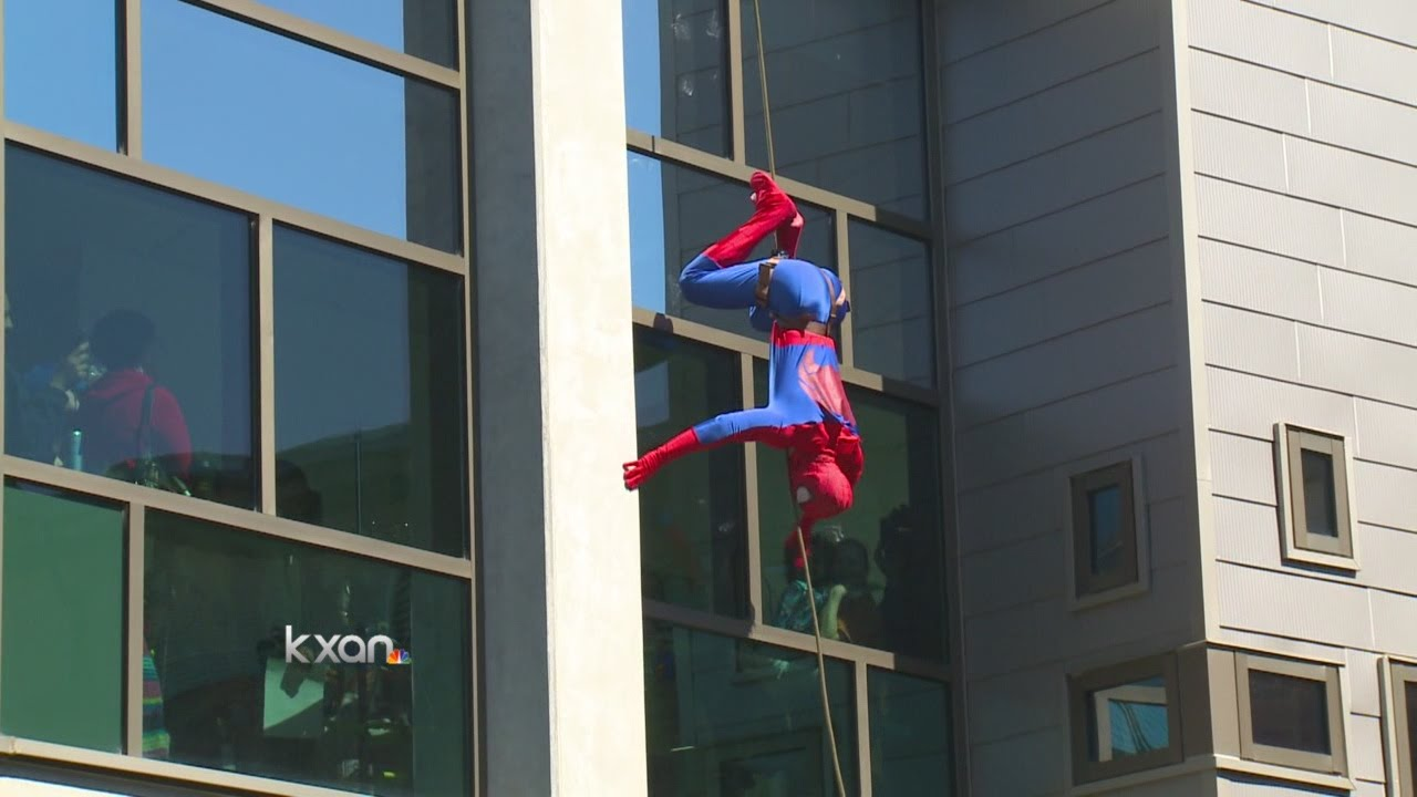 Austin Police dress up as Superheroes for kids at Dell Children's