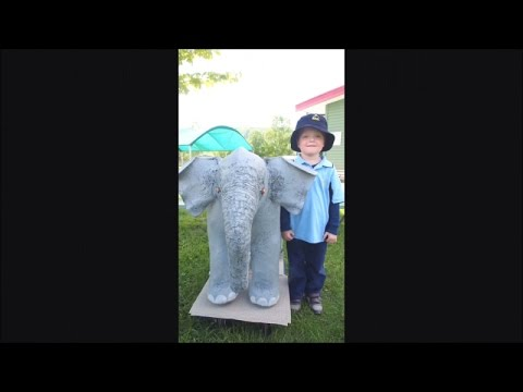 Mother And Son Make A Baby Elephant With Paper Mache