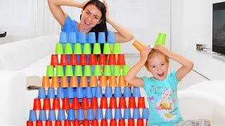 Caroline and Mom Play with colored cups