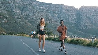 SKATEBOARDING ON TABLE MOUNTAIN IN CAPE TOWN, SOUTH AFRICA