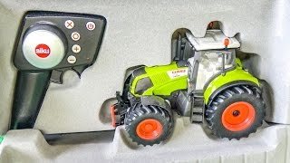 RC tractor gets unboxed and works hard for the first time!