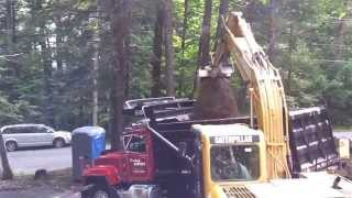 Loading a 10 Wheel Dump Truck with Cat 312