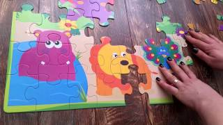 Giant puzzle for kids with animals : lion, hipo, giraffe, tiger, elephant....