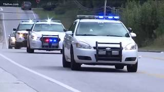 Gwinnett Police officer killed after approaching vehicle near middle school