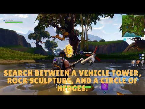 Search Between a Vehicle Tower, Rock Sculpture, and a Circle of Hedges.