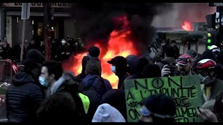 Tear gas, fires at Paris protest against police violence