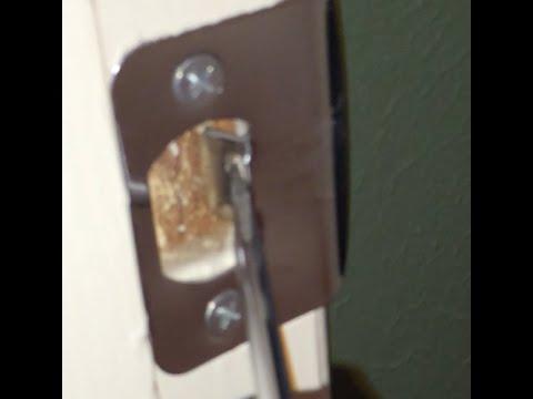 How to adjust door strike plate on rattling door. - YouTube