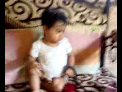 Jisha playing with Red BSNL phone and Dada giving commentary