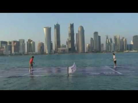 Rafael Nadal and Roger Federer play tennis on water in Doha