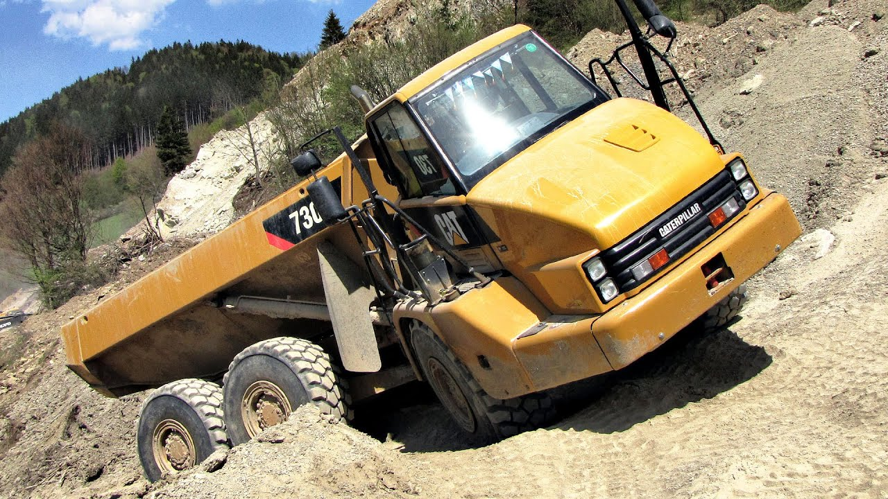 Caterpillar 730 dump truck in a quarry youtube