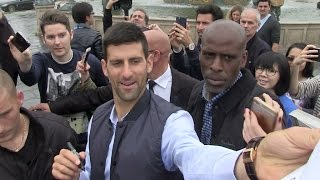 Novak Djokovic greets fans Place de la Concorde in Paris