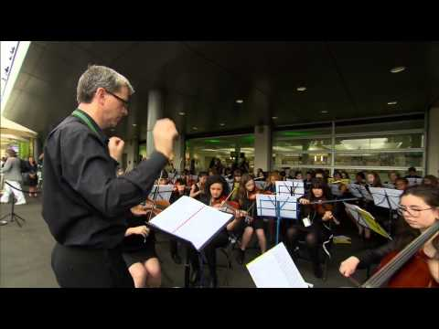 Wandsworth Pops Orchestra opens Day 8 at SW19