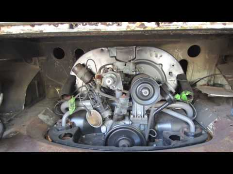 vw double cab in the garage with messed up metal