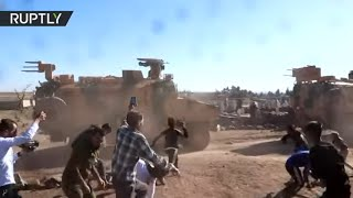 Protesters pelt Turkish vehicles with rocks during joint patrol with Russian troops in Syria