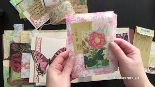 This Altered file folder is full of ephemera from the Calico Collag...