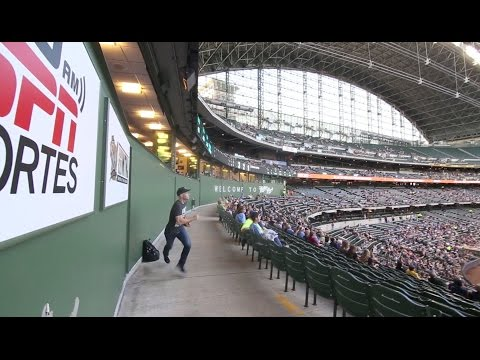 Snagging two foul balls during the game at Miller Park