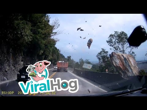 Falling Boulder Nearly Hits Multiple Cars || ViralHog