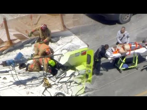 Four confirmed dead in Florida pedestrian bridge collapse