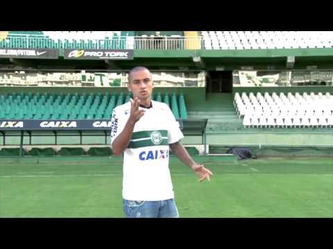 Van Damme presents Coritiba's new signing.