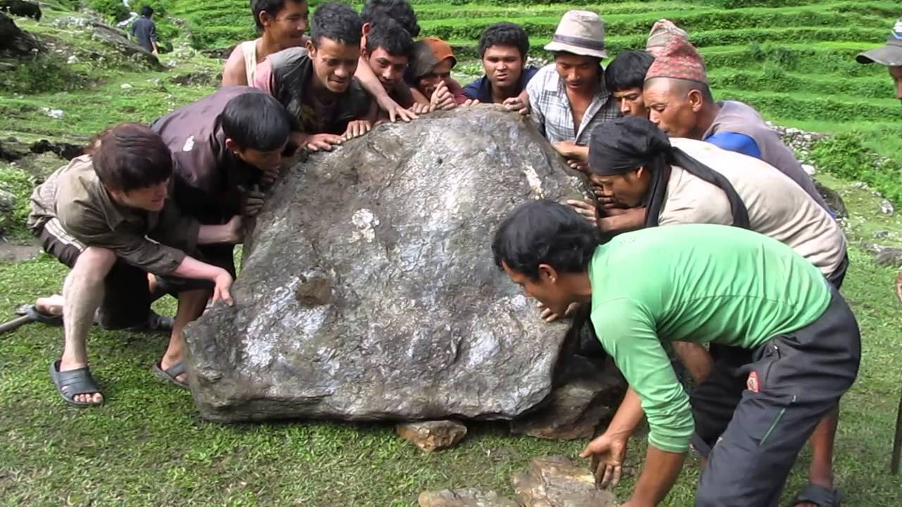 2017 Nepal Group Of Men Move A Large Rock