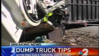 Dump truck cleanup begins after it flips