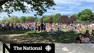 People crowd Toronto park as COVID-19 restrictions compete with summer weather