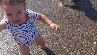children play ta the beach ,kids boys