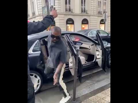 Kanye West making sure he avoided that puddle and kept his Yeezy 451s clean
